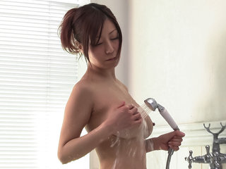 Passionate Chihiro Akino plays with her big tits and pussy