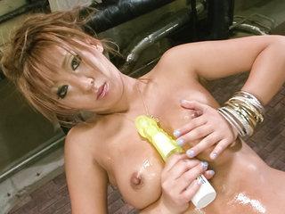 Japanese av model Hina Maeda in gold lame strips and teases her titties